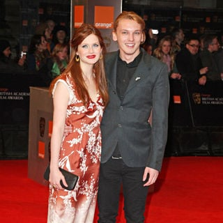 Bonnie Wright, Jamie Campbell Bower in 2011 Orange British Academy Film Awards (BAFTAs) - Arrivals