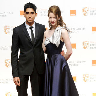 Dev Patel, Talulah Riley in 2011 Orange British Academy Film Awards (BAFTAs) - Press Room