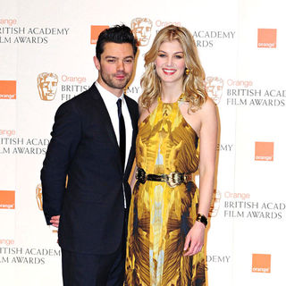 Dominic Cooper, Rosamund Pike in 2011 Orange British Academy Film Awards (BAFTAs) - Press Room