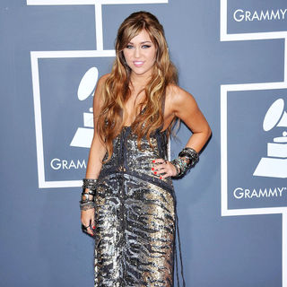 Miley Cyrus in The 53rd Annual GRAMMY Awards - Red Carpet Arrivals