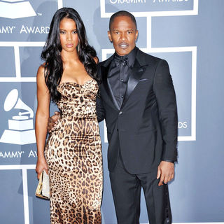 Britt Loren, Jamie Foxx in The 53rd Annual GRAMMY Awards - Red Carpet Arrivals