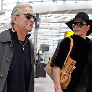 Michael Douglas, Catherine Zeta-Jones in Michael Douglas and Catherine Zeta-Jones Arriving at Heathrow Airport