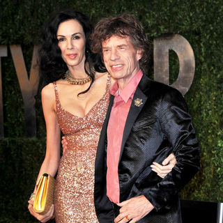 L'Wren Scott, Mick Jagger in 2011 Vanity Fair Oscar Party - Arrivals