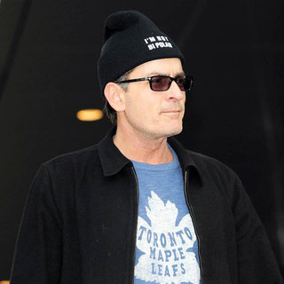 Charlie Sheen Departs His Hotel and Proceeds to Walk to Massey Hall - wenn3297200