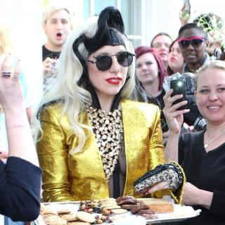 Lady GaGa in Lady GaGa Appears Outside her London Hotel to Give Out Cookies and Flowers to Her Fans