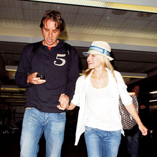 Kristen Bell, Dax Shepard in Kristen Bell and Dax Shepard are in good spirits as they arrive at LAX airport
