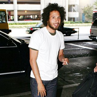 Zack de la Rocha, Rage Against the Machine in Zack de la Rocha of Rage Against the Machine enjoys a cigarette as he arrives at LAX Airport