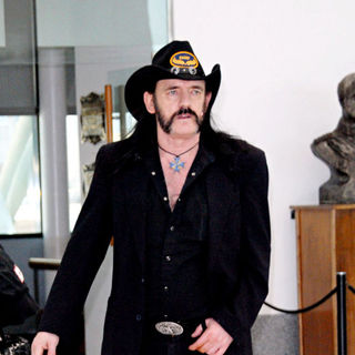Motorhead - Lemmy of Motorhead arrives at he airport to check in his luggage, before boarding a flight to Brazil