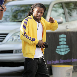 Lil Wayne - Lil Wayne arrives for the first game of the NBA National Championship Tournament
