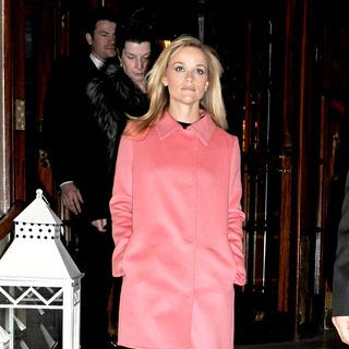 Reese Witherspoon - Reese Witherspoon departs her hotel wearing a bright pink coat