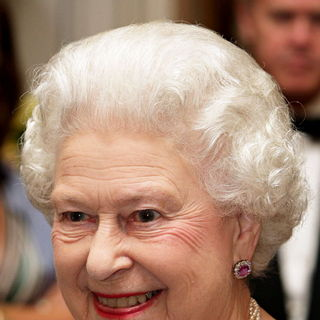Queen Elizabeth II in Queen Elizabeth II Smiles During A Reception at Mansion House