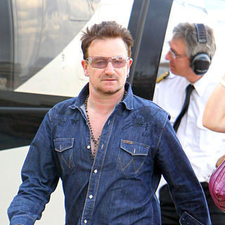 Bono in Bono Arriving to Monaco Airport by Helicopter