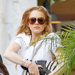 Lindsay Lohan in Lindsay Lohan Leaving 'Barneys New York' while Shopping at The Grove