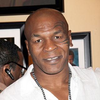 Mike Tyson in Mike Tyson Signs Autograph