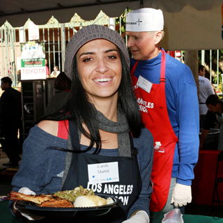 Carole Marini in Celebrities Volunteer on Christmas Eve to Serve The Homeless