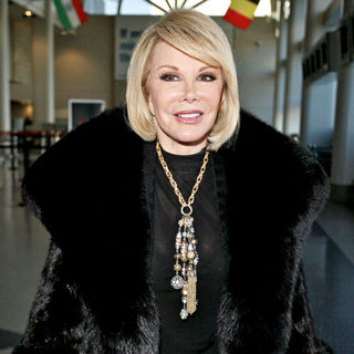 Joan Rivers in Joan Rivers Arriving at LAX Airport with Her Daughter to Catch A Flight