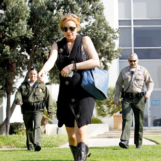 Lindsay Lohan in Lindsay Lohan Carrying A Large Blue and Gold Bag Outside The Santa Monica Courthouse