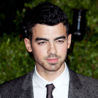 Joe Jonas, Jonas Brothers in 2011 Vanity Fair Oscar Party - Arrivals