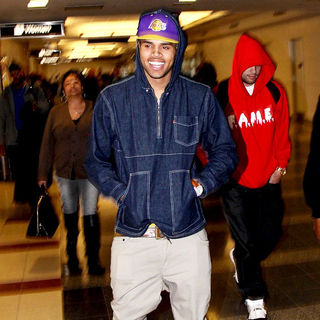 Chris Brown in Chris Brown Arrives at Ronald Reagan National Airport to Promote His New Album 'F.A.M.E.'