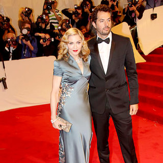 Madonna, Guy Oseary in Alexander McQueen: Savage Beauty Costume Institute Gala