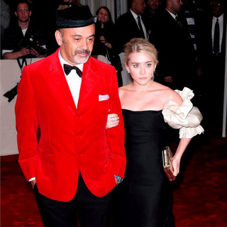 Christian Louboutin, Ashley Olsen in Alexander McQueen: Savage Beauty Costume Institute Gala