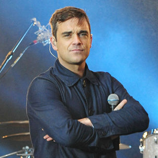 Robbie Williams in Robbie Williams Performing Live at A Free Open Air Concert Outside Max-Schmeling-Halle hall