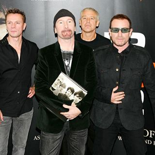 U2 in U2 Sign Copies of 'U2 BY U2'