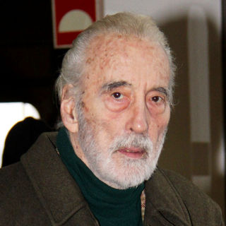 Christopher Lee in Christopher Lee Walking with A Cane as He Is Checking In at Tegel Airport