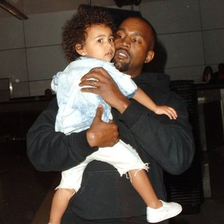 Kanye West - Kanye West and North West at Los Angeles International Airport