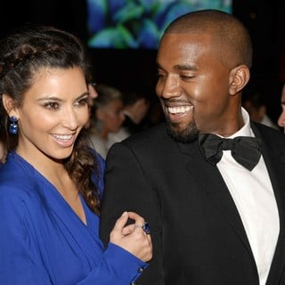 Kim Kardashian, Kanye West in The Angel Ball 2012
