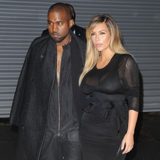 Kanye West, Kim Kardashian in The Givenchy Show During Paris Fashion Week
