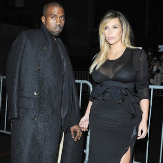 Kanye West in The Givenchy Show During Paris Fashion Week - west-kardashian-givenchy-show-02