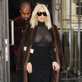 Kanye West - Kim Kardashian and Kanye West Leave Their Hotel in Paris