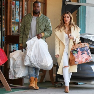 Kanye West, Kim Kardashian in Kim Kardashian and Kanye West Shop at Sport Store