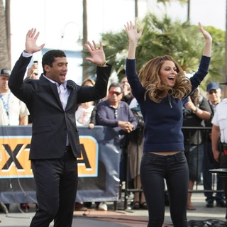 Russell Wilson, Maria Menounos in Russell Wilson Filming Extra