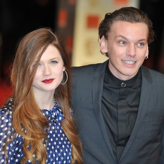 Bonnie Wright, Jamie Campbell Bower in Orange British Academy Film Awards 2012 - Arrivals