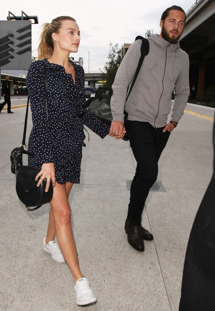 Margot Robbie, Tom Ackerley<br>Margot Robbie and Tom Ackerley at Los Angeles International Airport