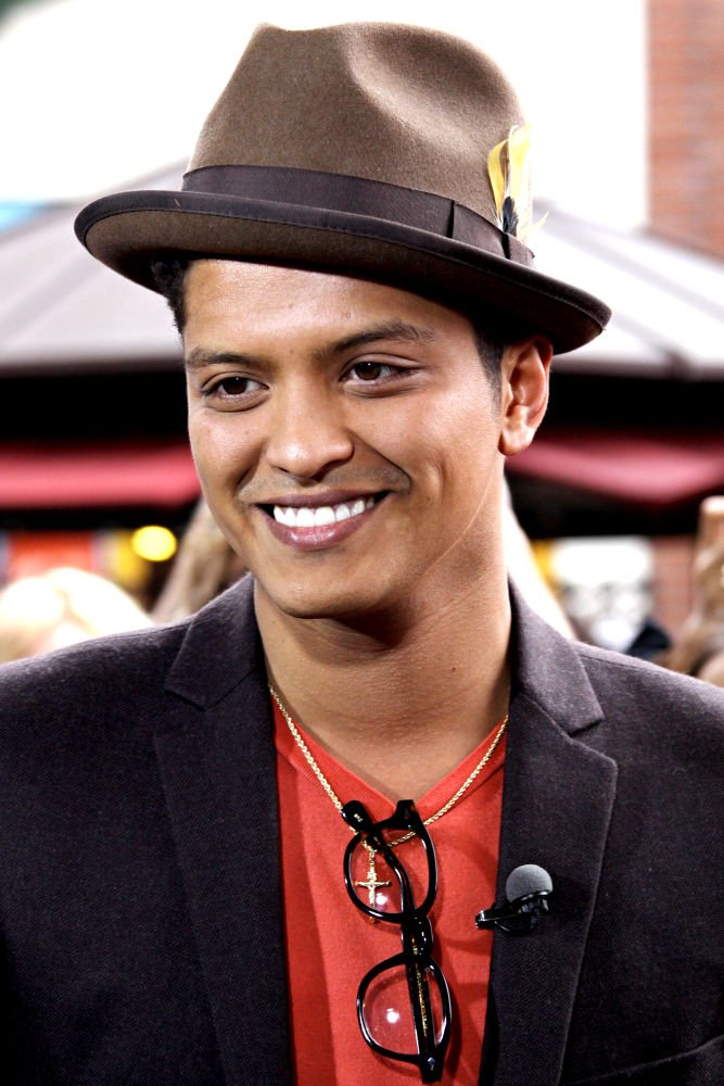 "R&B star Bruno Mars is ""embarrassed"" by his recent arrest for cocaine"